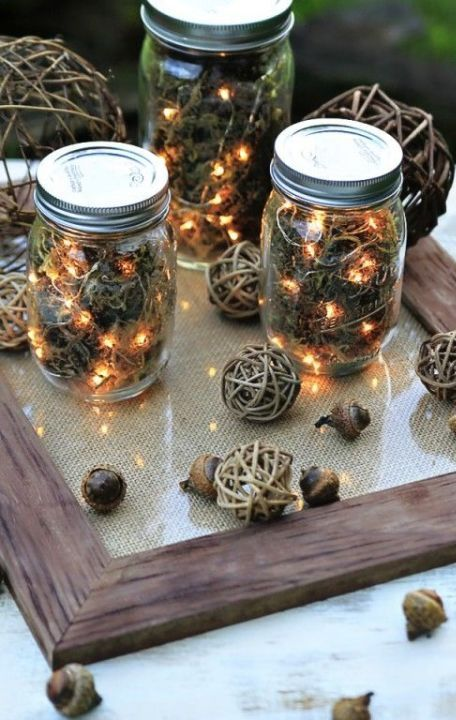 use dried moss, acorns, and string lights to craft these rustic lanterns