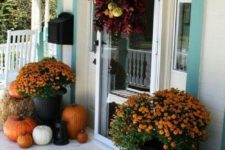 12 fall and Thanksgiving porch decor with pumpkins and orange flowers