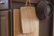 12 make hooks on the sides of your cabinets and hang baskets or cutting boards there