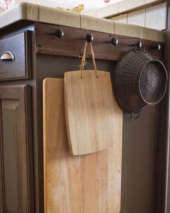 make hooks on the sides of your cabinets and hang baskets or cutting boards there
