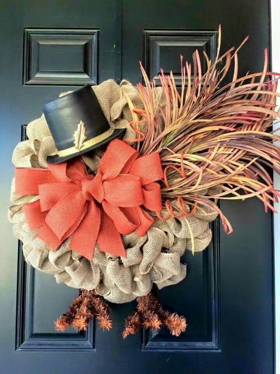mesh burlap ribbon, faux herbs and a hat for a bold turkey wreath