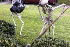 12 skeletons making a grave in the garden