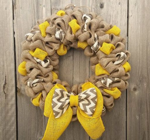 burlap and yellow mesh wreath with a bow