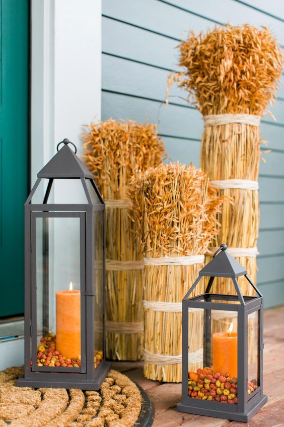 candle lanterns and wheat placed on your porch is a simple fall idea that is easy to recreate
