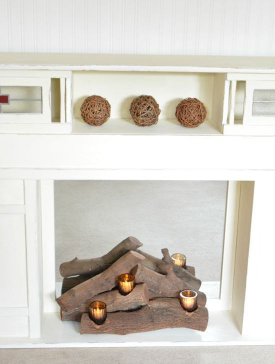 place real logs and insert candles in candle holders there