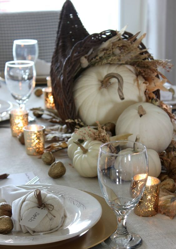 rustic table decor with a cornutopia centerpiece, fabric pumpkins and gilded nuts