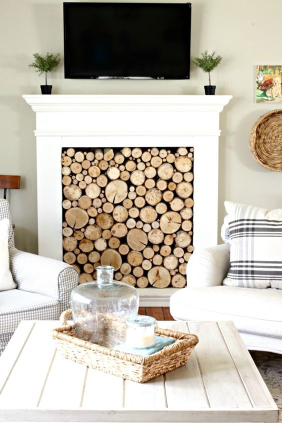 faux wood log panel to make a fireplace look cool