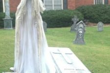 14 grave and a ghost in the garden for creepy decor