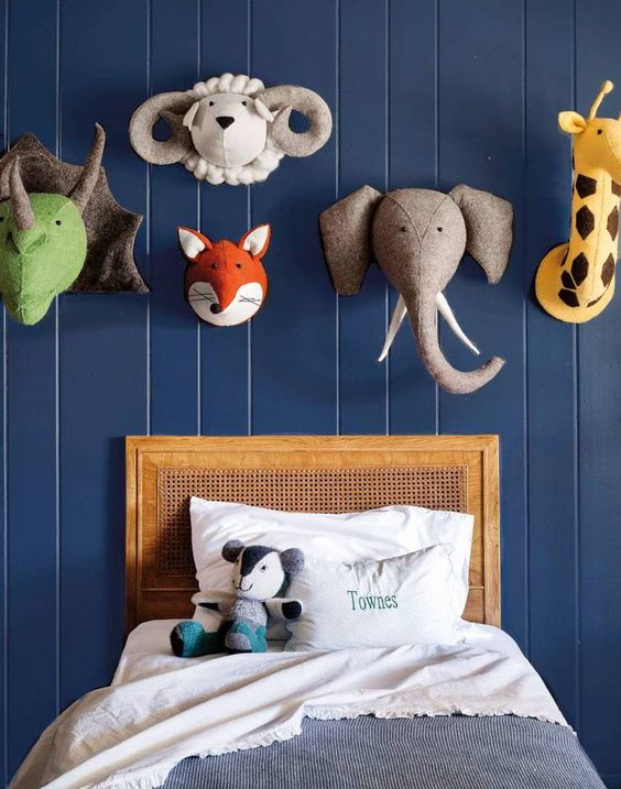 highlight the headboard wall with colorful soft animal heads