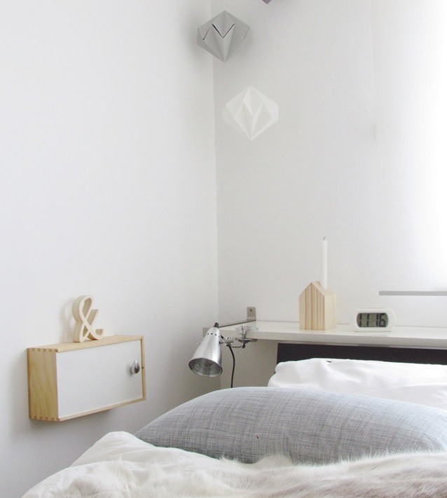 shelf atop a headboard to give you some space