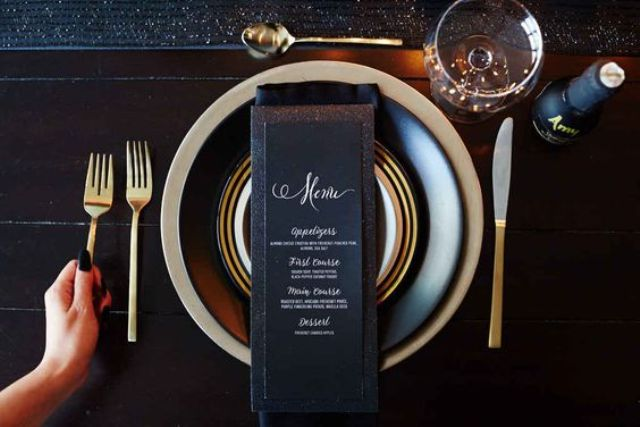 simple black and gold table decor looks classy