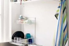 15 a small wall-mounted shelf will hold your recipe and cookbooks