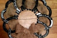 15 black horseshoes and burlap as a wreath