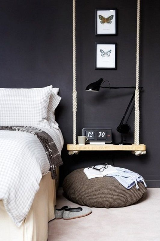 a shelf hanging on rope is a mobile piece
