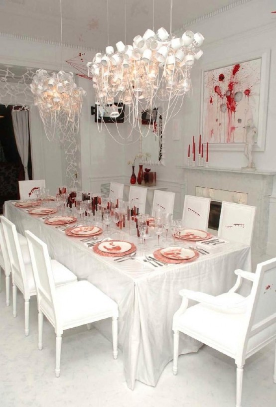 bloody Halloween table with blood in glass as the main decoration