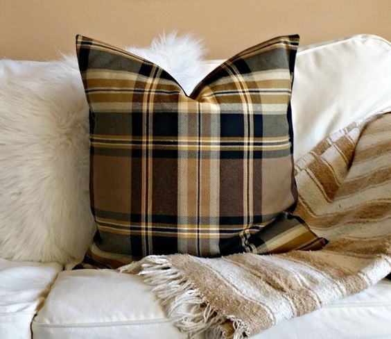 cozy plaid pillow will stand out in neutral decor