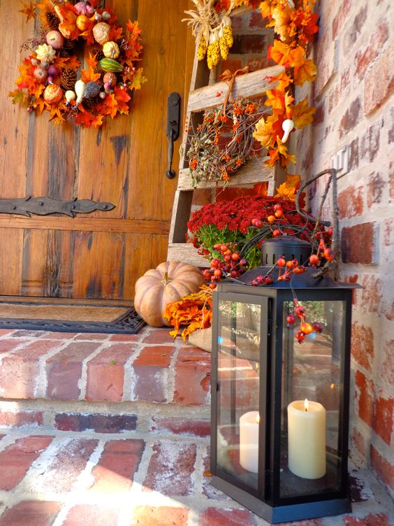 harvest porch decor with a lantern and faux fall stuff decor