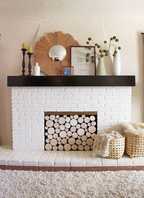 install a wood log panel to make your fireplace cozier