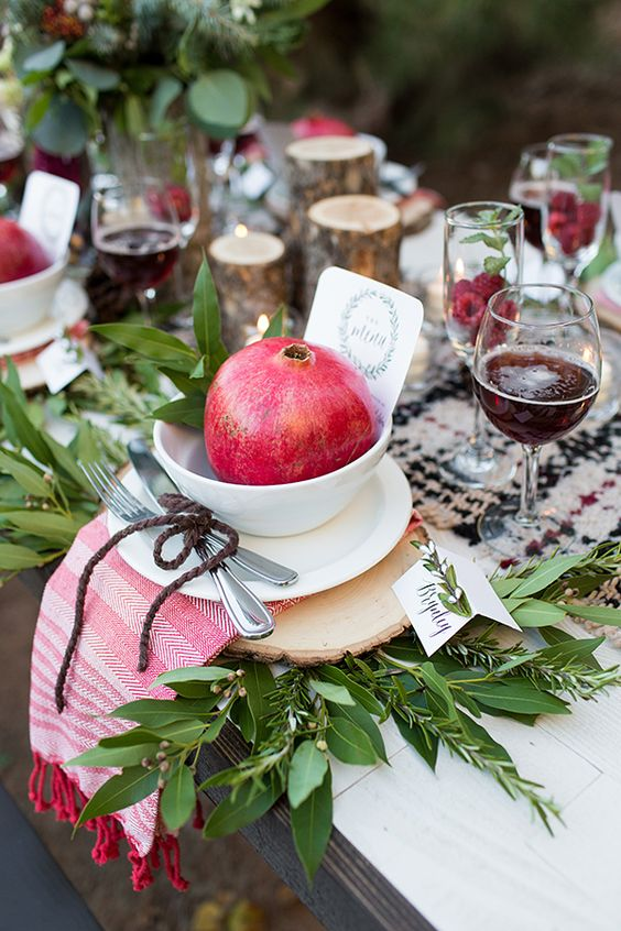 pomegranate table setting with greenery for Thanksgiving