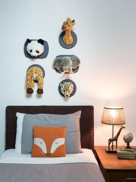 take parts of stuffed animals and attach them to the wall yourself