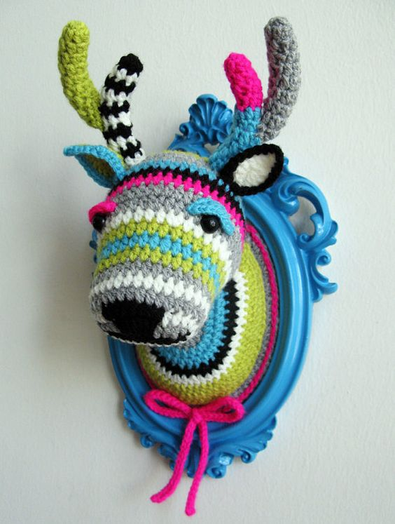 crochet a deer head in super bold colors and your kids will be amazed