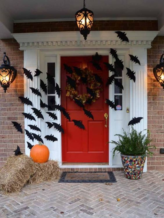 easy front door decor with cardboard bats attached to it
