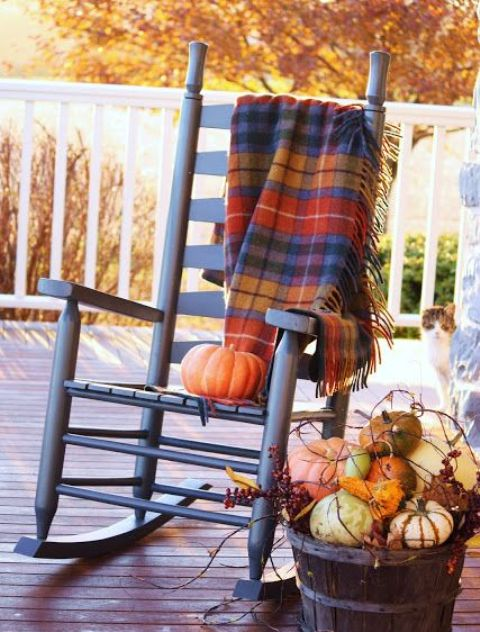 place a bold plaid blanket on a rocker to keep warmer while sitting outdoors
