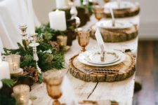 17 rustic yet elegant table setting with fir, pinecones, candles and wood slices as chargers