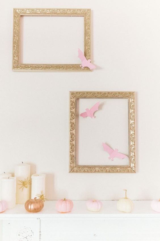 blush Halloween mantel with framed pink bats