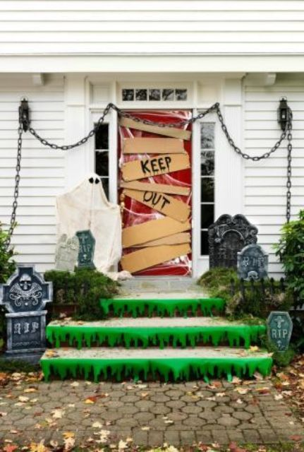 cemetry-inspired porch decor with Keep Out door decor