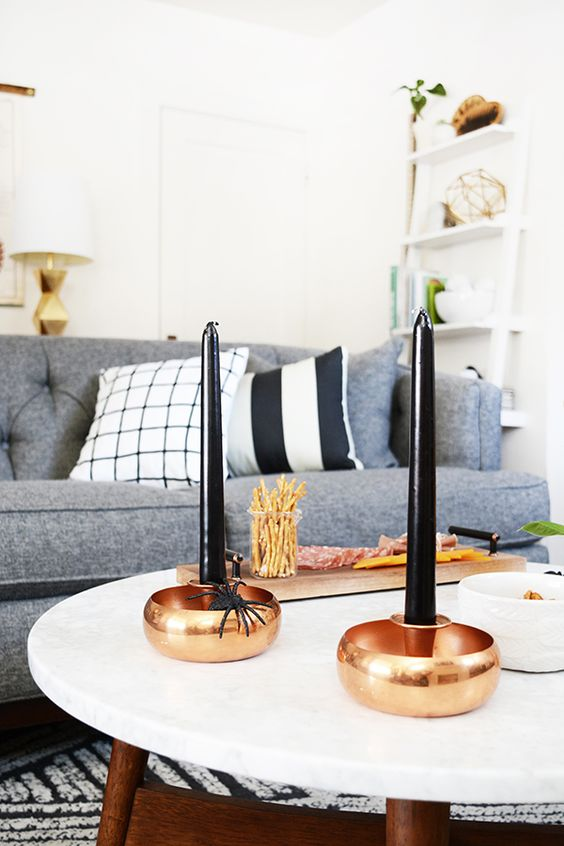 copper candle holders with black candles
