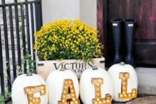 18 create an amazing outdoor arrangement with pumpkins and marquee letters inserted