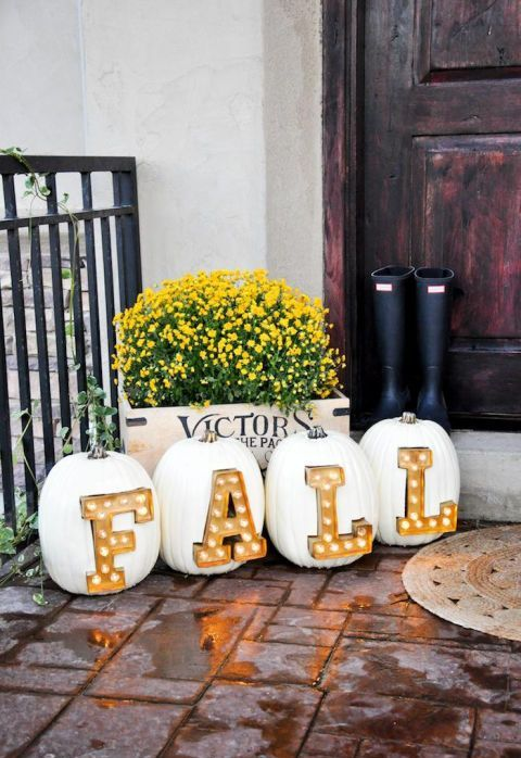 create an amazing outdoor arrangement with pumpkins and marquee letters inserted