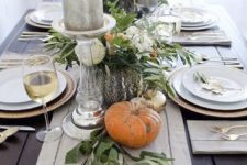 18 modern table decor with a table runner of pumpkins, candles and greenery