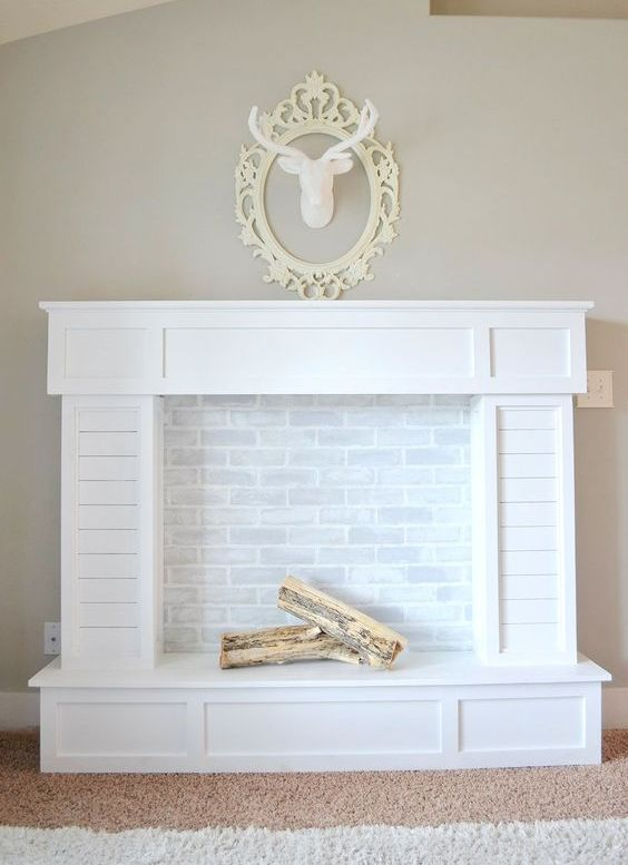 traditional-looking faux fireplace with white brick and firewood