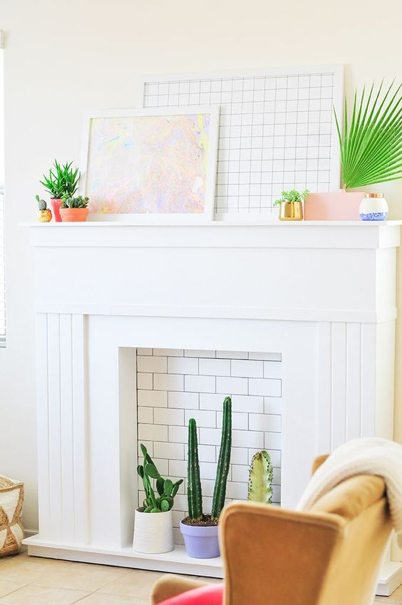 add a white brick panel and place your potted cacti inside