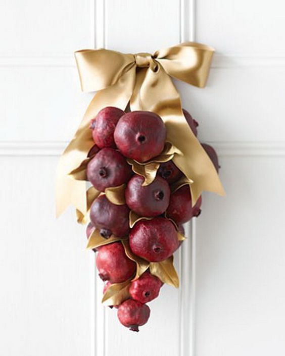 adorable pomegranate and gold ribbon door hanging