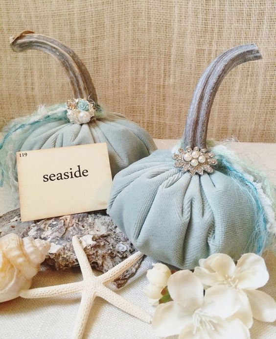 coastal decor with dusty blue pumpkins and shells