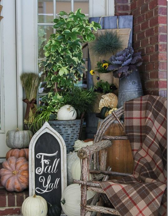 plaid blanket for fall porch decor and to feel comfy wwhile staying there