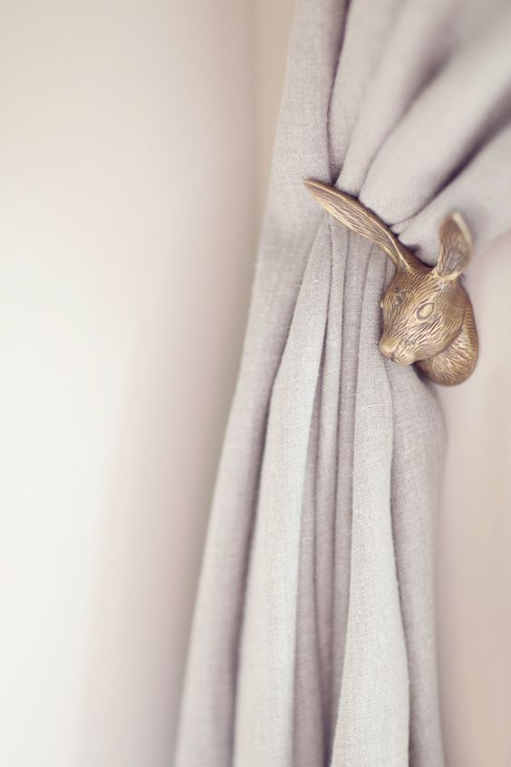 use bunny heads to hold draperies and curtains