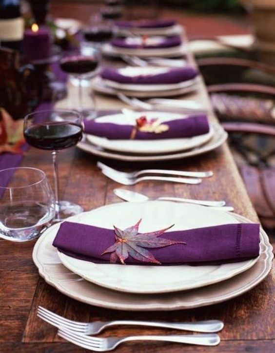 bold purple table decor with real leaves