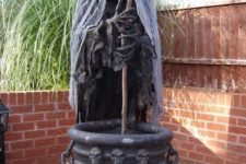 20 creepy witch with a cauldron can be placed in your backyard or garden