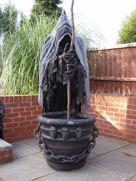 creepy witch with a cauldron can be placed in your backyard or garden