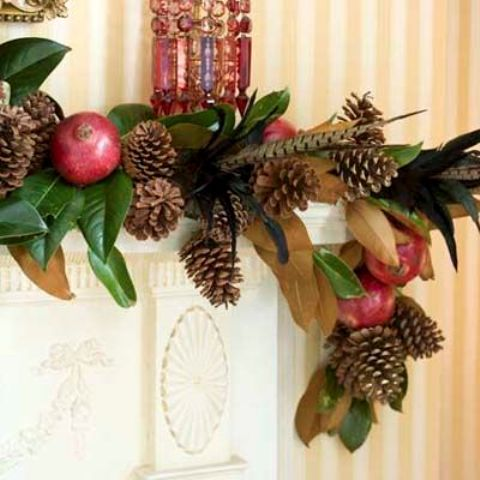 holiday garland with leaves, feathers, pinecones and pomegranates