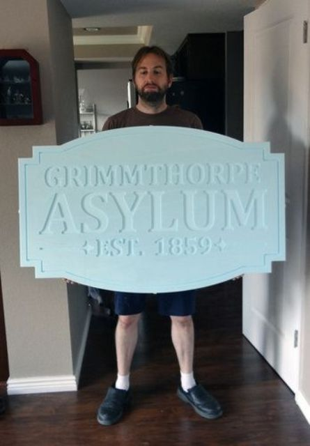 life sized sign out of blue foam