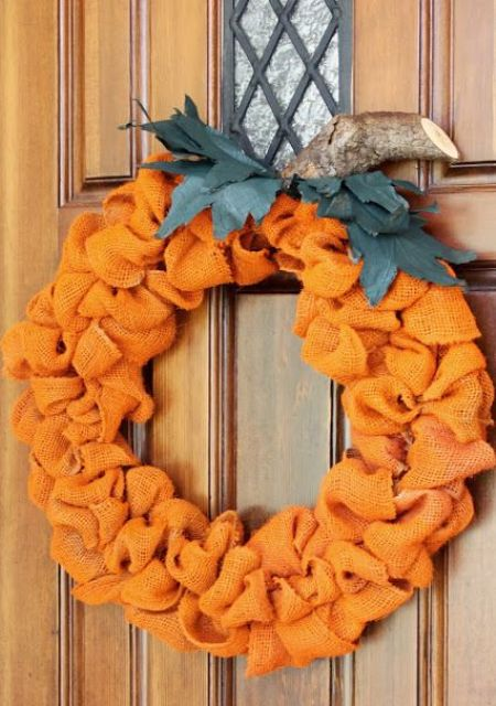 pumpkin wreath of bold burlap ribbon and a piece of branch