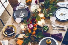 21 bold tablescape with leaves, fruit and flowers and purple napkins