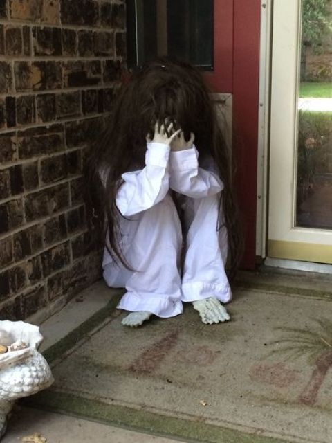crying scary child sitting on your front porch will frighten trick-or-treaters