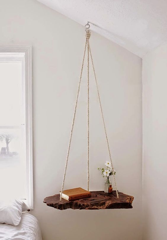 hanging rough wood piece on rope looks natural and cool