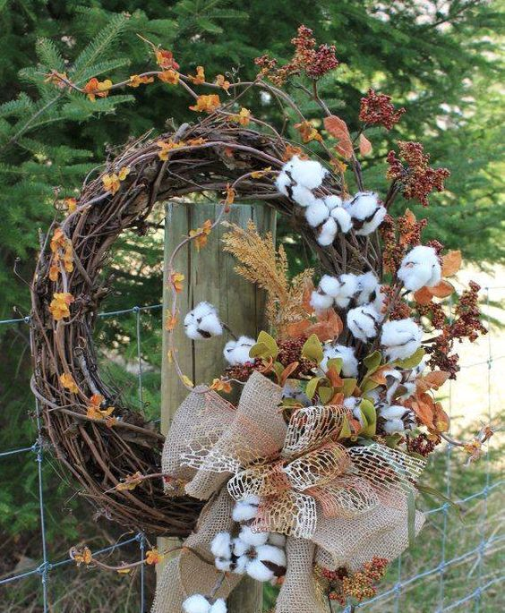 cotton wreath with faux leaves, herbs and a bow